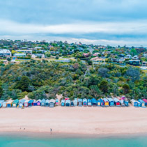 Aerial view of colorful beach huts on Mills Beach in Mornington, Victoria, Australia