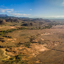 Large aerial panorama of Flinders Ranges mountain range and rural road in South Australia