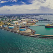 Aerial panorama of Williamstown suburb and industrial wharfs in summer. Melbourne, Australia