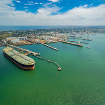 Aerial view of oil tanker moored at industrial port. Williamstown, Victoria, Australia