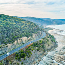 Cars driving on Great Ocean Road, Victoria, Australia