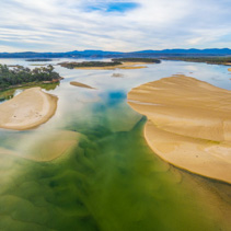 Aerial view of Wallagaraugh river mouth - shallow turquoise water and sand. Beautiful Australian Landscape