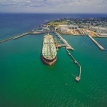 Aerial landscape of oil tanker moored at industrial port. Williamstown, Victoria, Australia