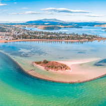 Aerial panorama of shallow ocean water and coastline. Narooma, NSW, Australia