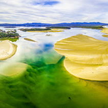 Aerial panoramic view of Wallagaraugh river mouth - shallow turquoise water and sand. Beautiful Australian Landscape