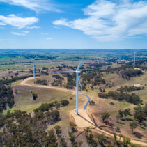 Aerial view of wind turbines on bright sunny day in New South Wales, Australia