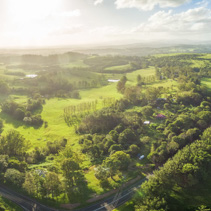 Aerial panorama of countryside with meadows and pastures at sunset in New South Wales, Australia