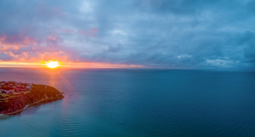 Sunset over water on Mornington Peninsula, Victoria, Australia