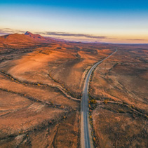 The Outback Highway passing through Flinders Ranges at dusk - aerial view