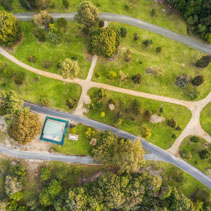Aerial view of Mallacoota coastal reserve - beautiful garden, trees, grass, walking paths. Victoria, Australia