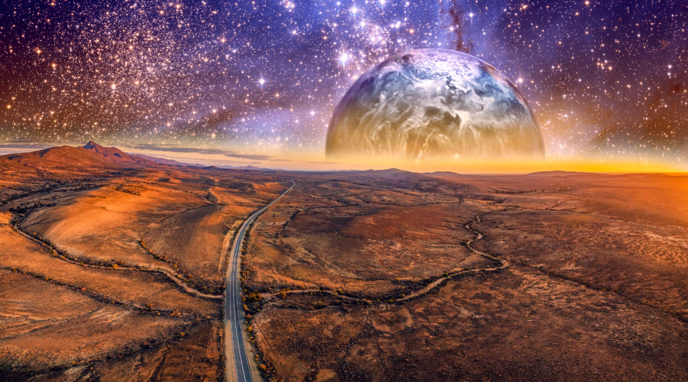Alien planet rising over desert landscape with vivid starry sky and highway. Elements of this image are furnished by NASA
