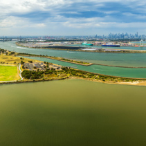 Aerial panorama of Yarra River Mouth with Melbourne CBD skyline on the horizon