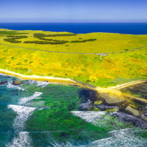 Aerial panoramic view of Phillip Island coastline near The Nobbies Centre and Round Island. Melbourne, Victoria, Australia