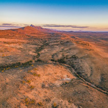 Red hills and rugged peak at sunset in Flinders Ranges, South Australia