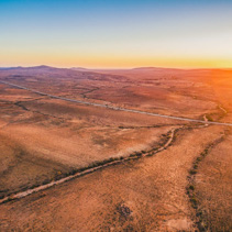 Sunset sun flare over alien landscape of Flinders Ranges in South Australia