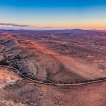 Aerial panoramic landscape of sunset sun flare over alien landscape of Flinders Ranges in South Australia