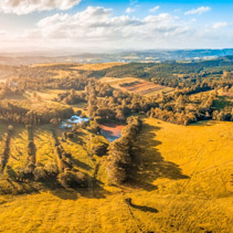 Meadows and pastures at sunset - scenic aerial panorama