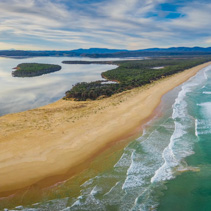 Aerial panorama of wild ocean coastline at sunset in Australia