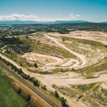 Aerial view of big limestone mine and mountains in Australia