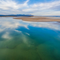 Aerial landscape - beautiful sky reflecting in shallow ocean water. Minimalistic landscape with copy space