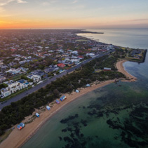 Aerial view of sunrise at Brighton Beach coastline. Melbourne, Victoria, Australia.