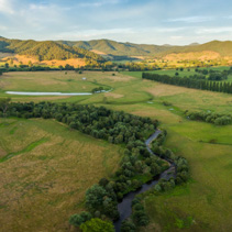Aerial panorama of meadows and pastures of Mitta Mitta Valley near Eskdale, Victoria, Australia at sunset
