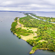 Aerial panoramic view of Silt Jetties, Eagle Point Bay and Jones Bay at Gippsland Lakes Reserve, Victoria, Australia
