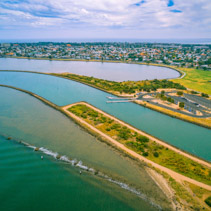 Aerial view of Yarra river mouth and Williamstown - coastal suburb in Melbourne, Australia