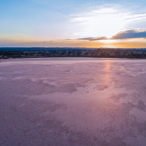 Aerial view of sunrise over pink salt lake Crosbie in Victoria, Australia