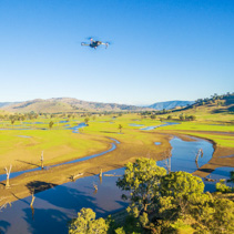 Aerial view of drone flying high above Australian Countryside on