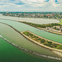 Aerial panorama of Yarra river mouth and Williamstown - coastal suburb in Melbourne, Australia