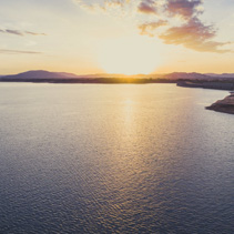 Sunset over Hume Dam and Lake Hume with copy space - aerial landscape