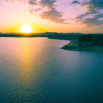 Amazing colorful sunset over lake in New South Wales, Australia - aerial panorama