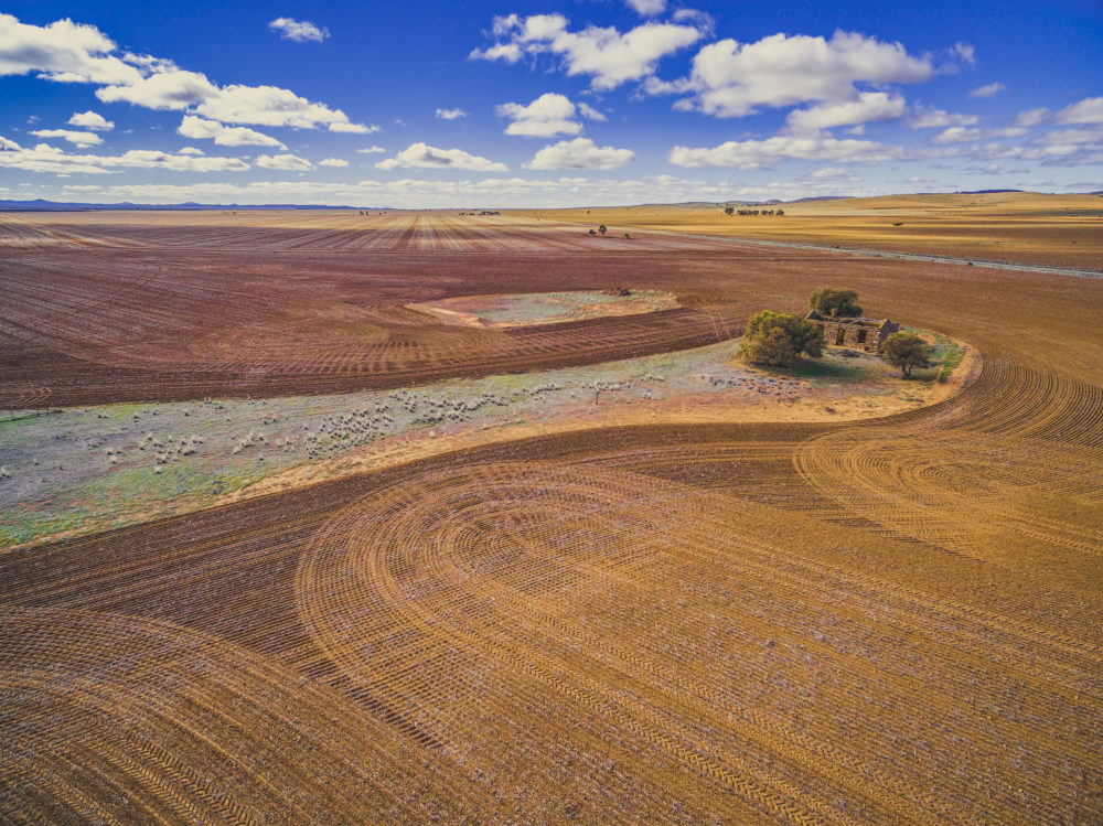 Plowed fields and old building ruins in South Australia - aerial view
