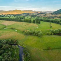 Aerial landscape of meadows and pastures of Mitta Mitta Valley near Eskdale, Victoria, Australia at sunset