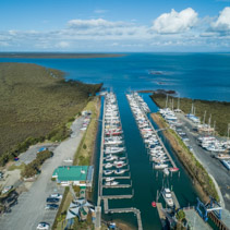 Moored boats at Yaringa Boat Harbour in Somerville, Australia