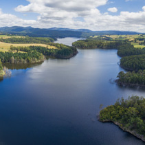 Aerial panoramic landscape of lake in Australian countryside.