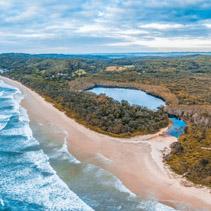 Ocean coastline under moody sky - beautiful aerial view