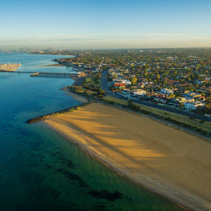 Aerial view of Brighton beach and suburb at sunrise. Melbourne,
