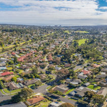Aerial panorama of suburbia in Australia on bright sunny day