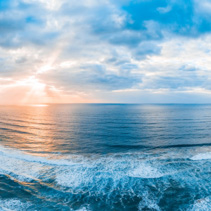 Scenic sunset over ocean waves - beautiful landscape panorama