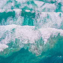 Looking down at powerful turquoise ocean waves