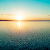 Sunset over water - aerial view with copy space