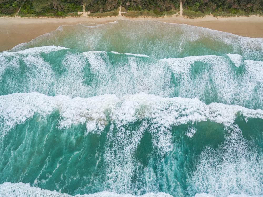 Powerful ocean waves crushing on sandy beach