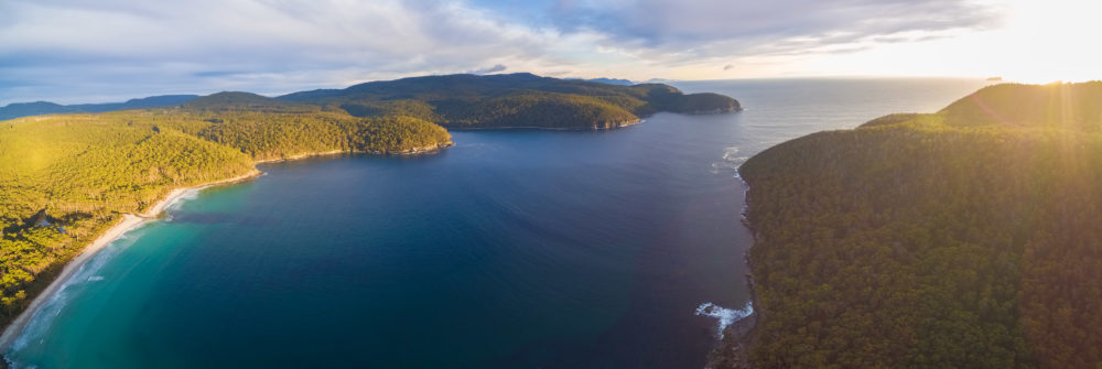 Aerial panorama of Fortescue Bay at sunset. Tasman National Park, Victoria, Australia