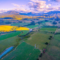 Aerial view of beautiful Australian countryside at sunset. Kiewa Valley, Victoria, Australia