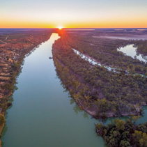 Murray River flowing to the horizon at beautiful sunset - aerial landscape