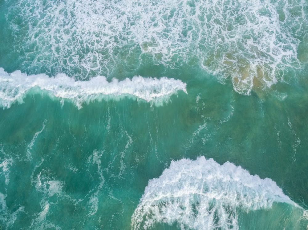 Large waves crushing - aerial view