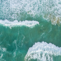 Large waves crushing - aerial view