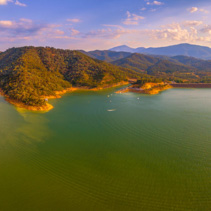 Large aerial scenic panorama of Lake Eildon dam at beautiful sunset